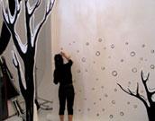 Yuko drawing snowflakes to backdrop